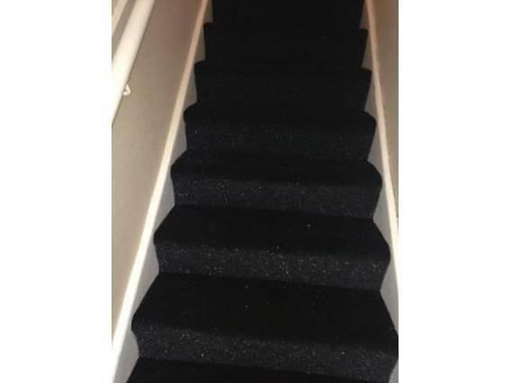 Black carpet on stairs