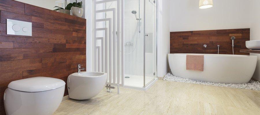 affordable bathrooms. a bathroom with cream floor and dark wood wall panels, long oval bath, affordable bathrooms i