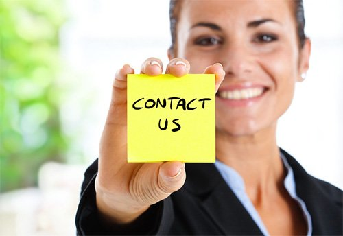 a lady showing CONTACT US note