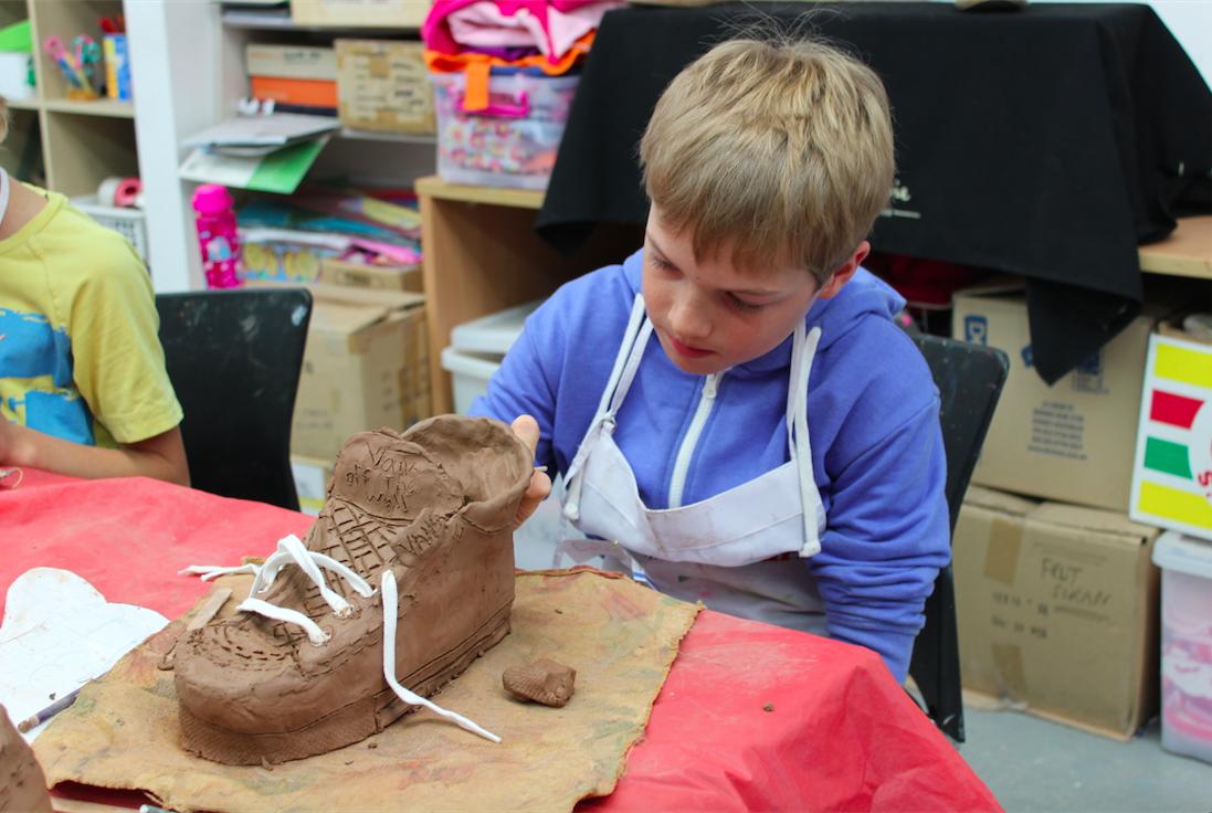 Boy is making a sculpture