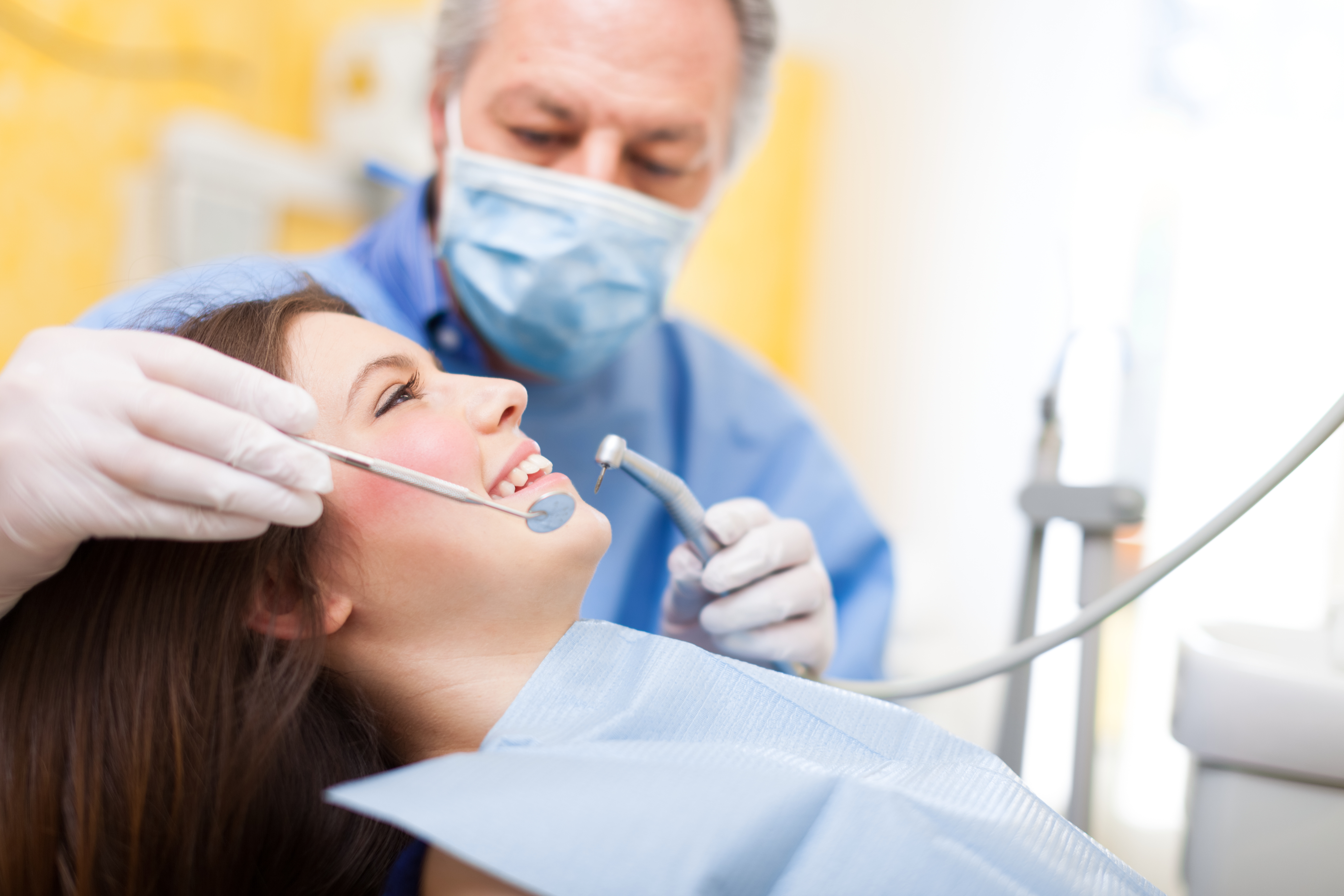 Woman satisfied with dentist services we provide