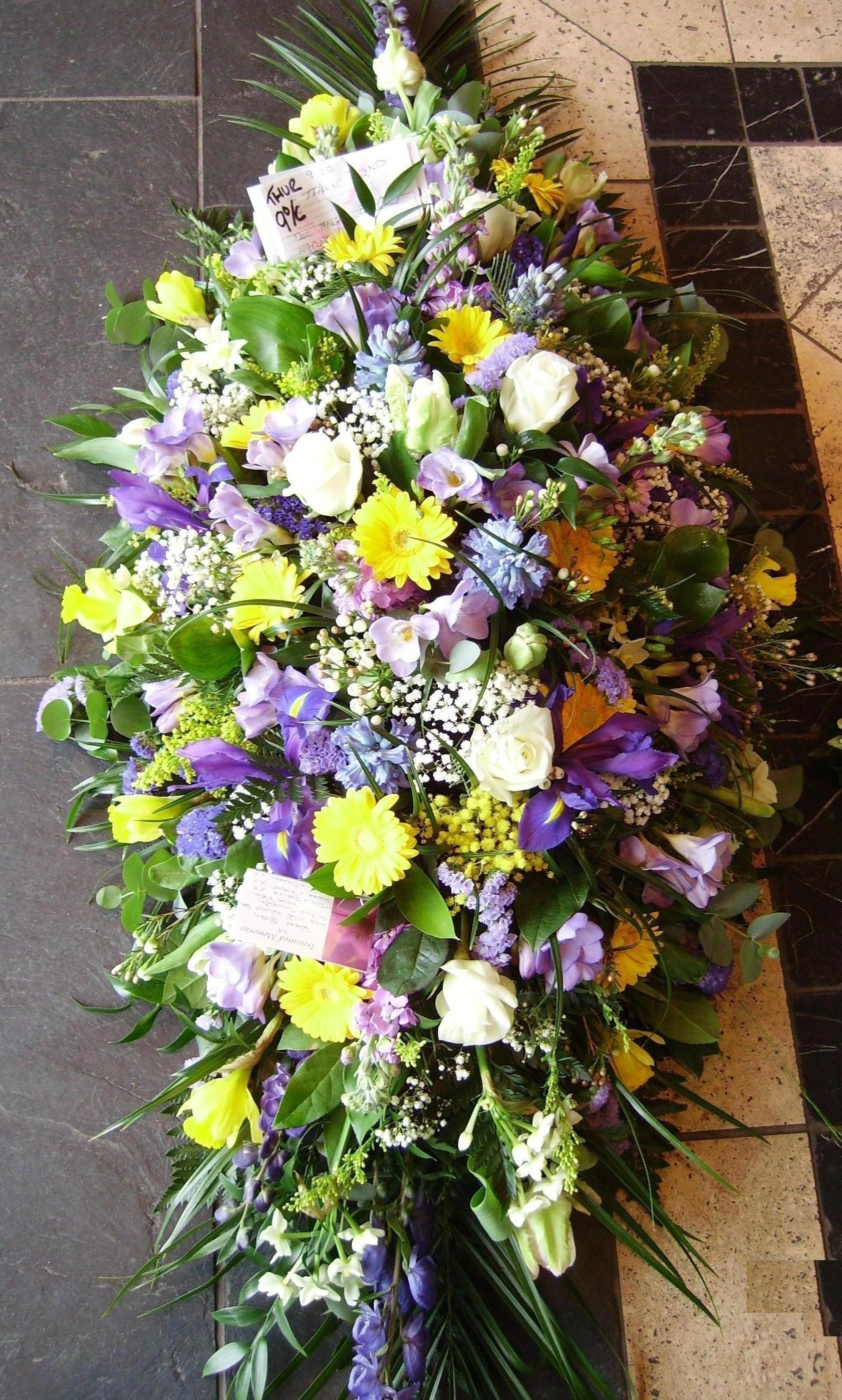 white, yellow and purple flowers