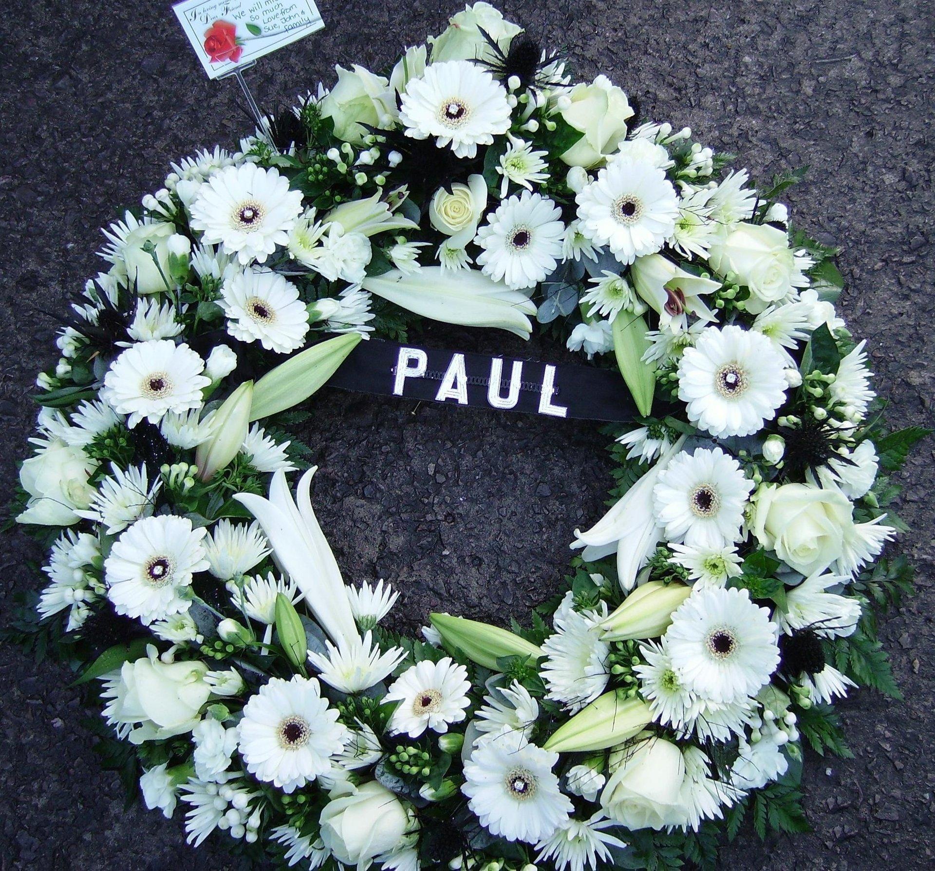 white tribute flowers