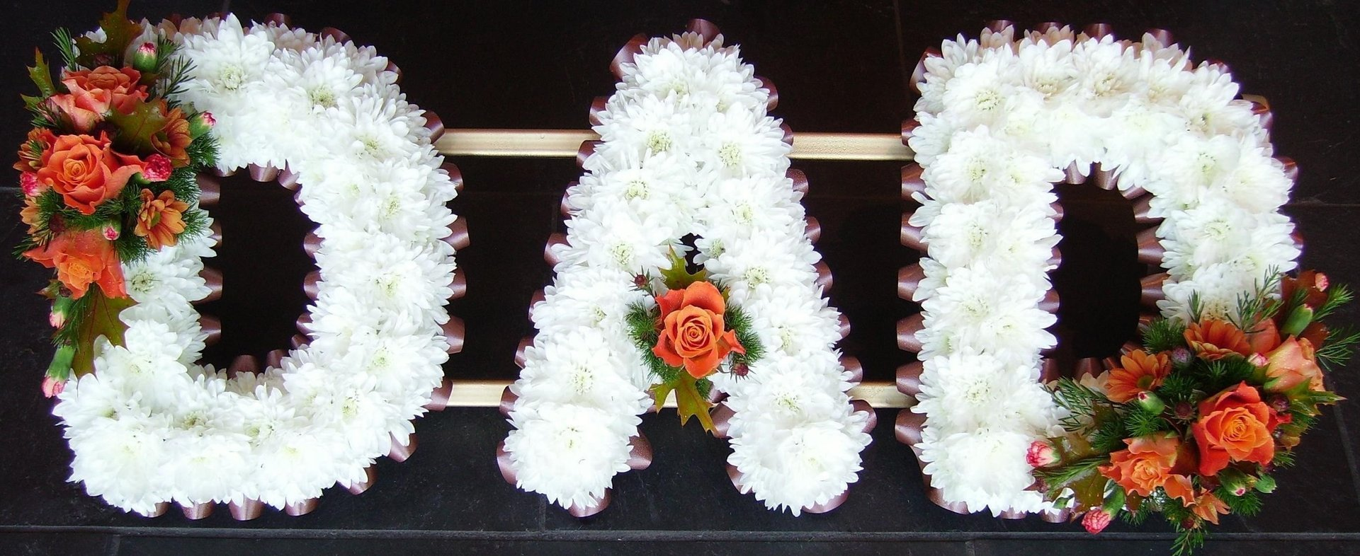 flowers made of DAD letters