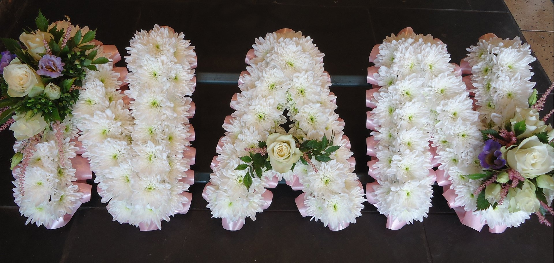 N A N lettered flowers