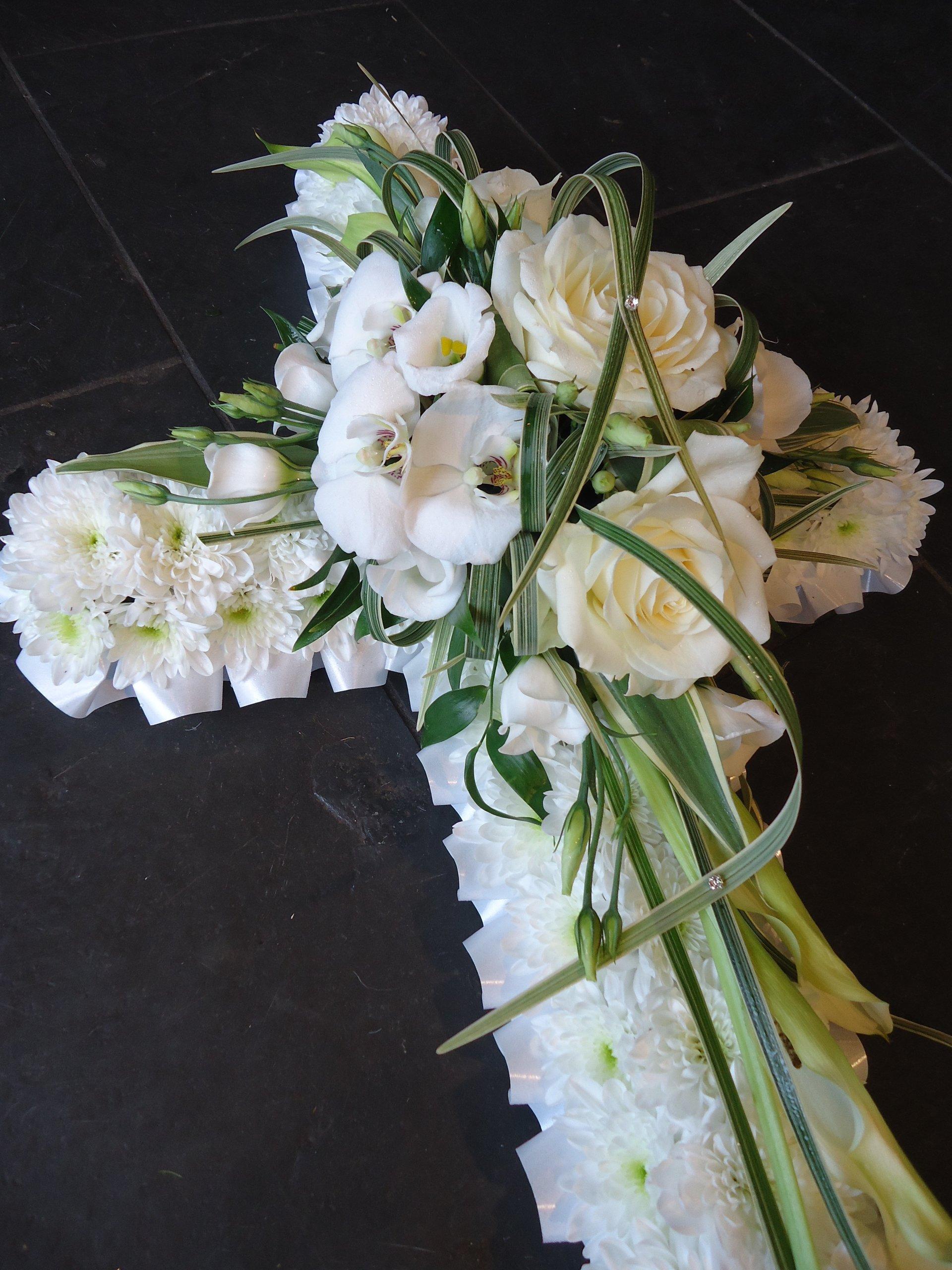white flowers cross