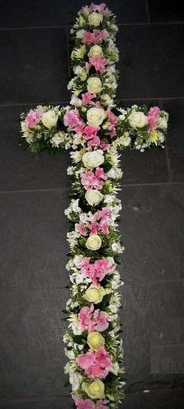 cross made of white and pink flowers
