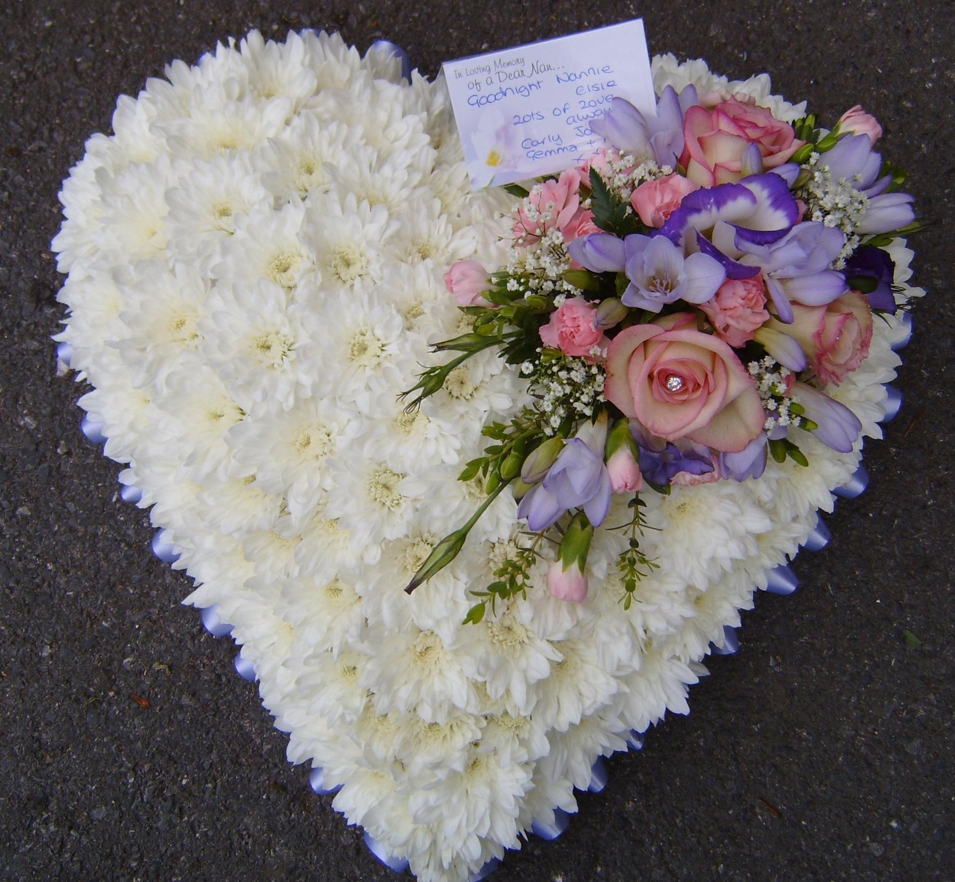 white and pink flowers in heart shape