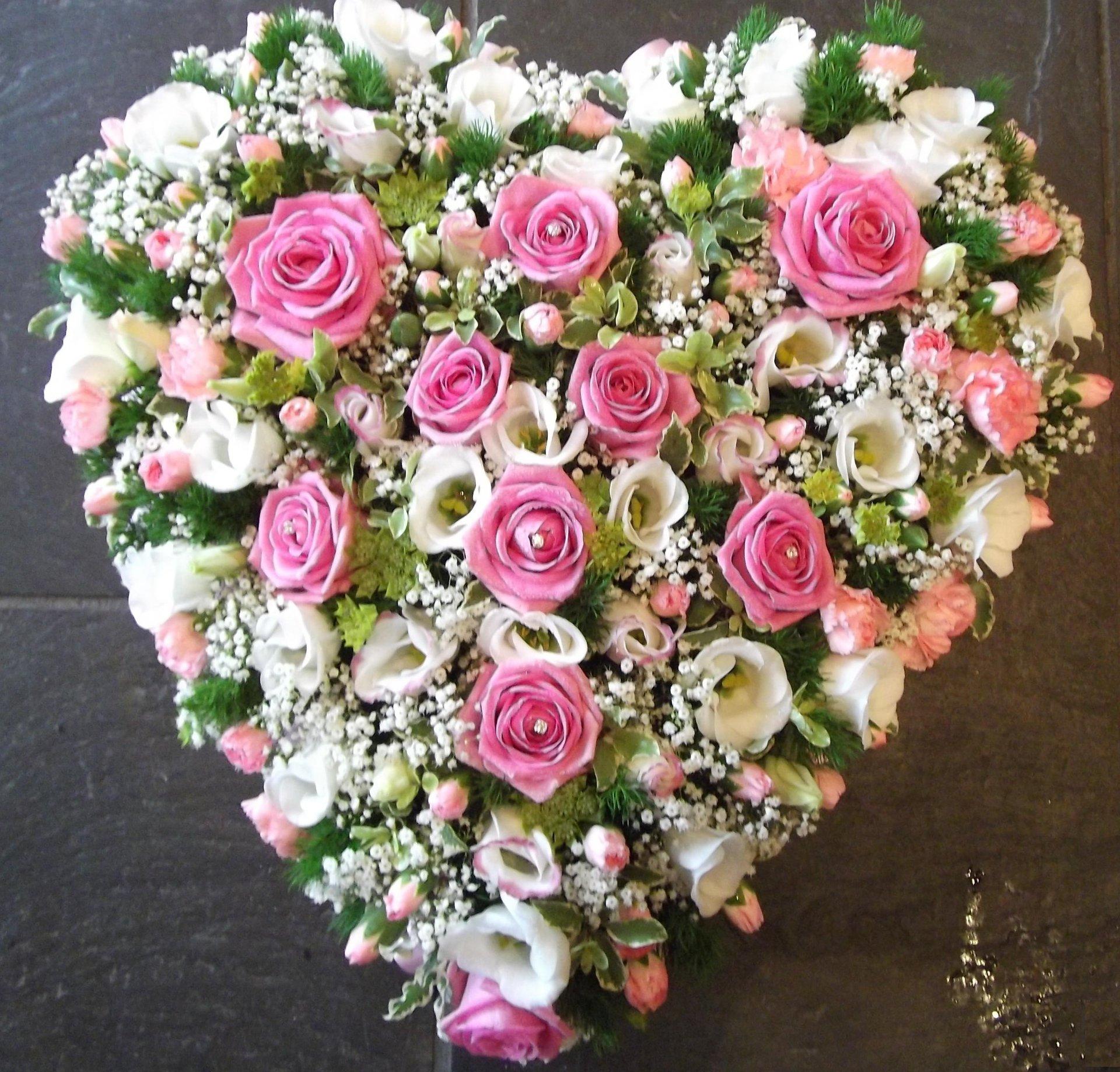 white flowers in heart shape