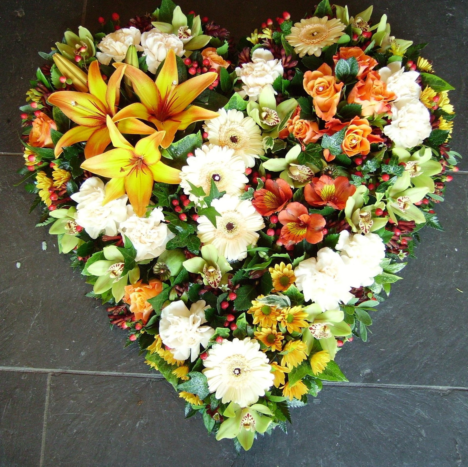 yellow and white flowers in heart shape