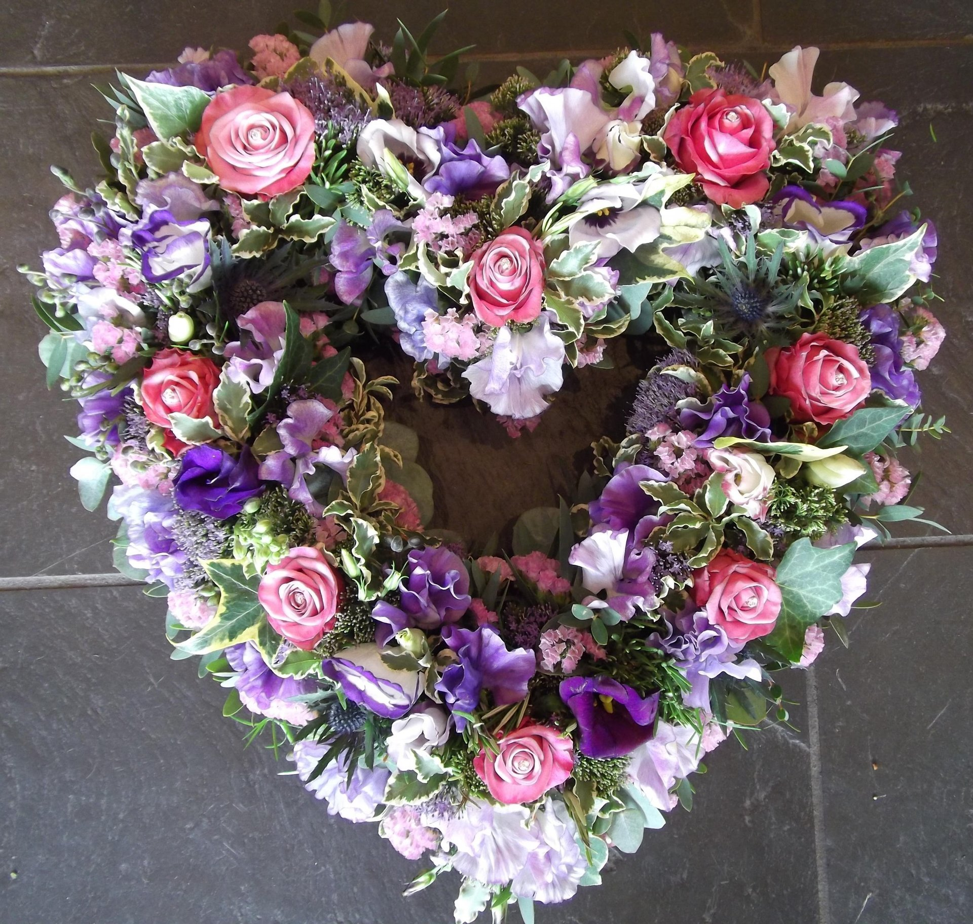 white, pink and purple flowers in heart shape