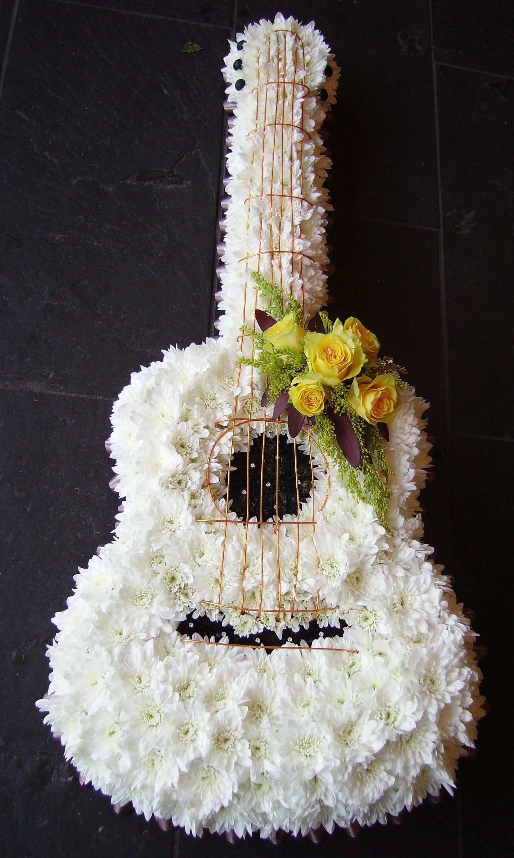 flowers arranged in guitar shape
