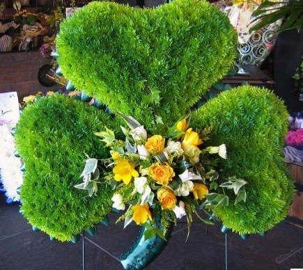 flowers arranged in a leaf shape
