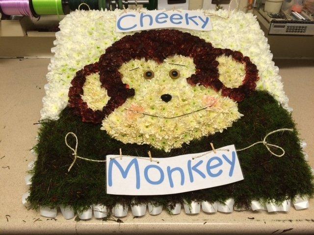 flowers arranged in monkey shape