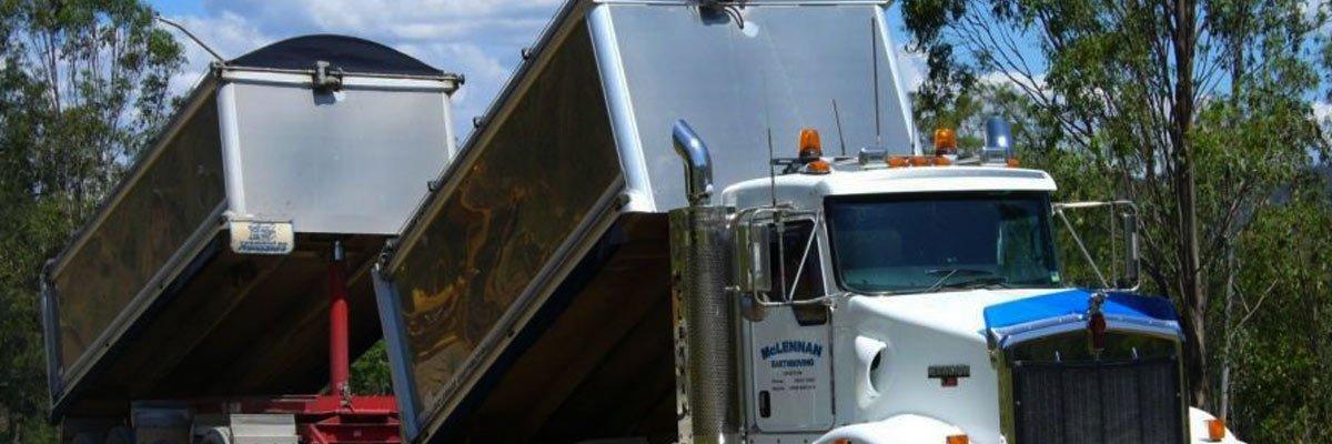 mclennan earth moving dual tipper trucks