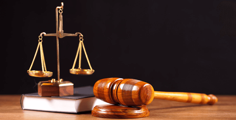 Wooden gavel and scale to represent law in Torrington