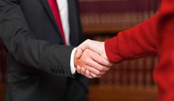 Lawyer and client shaking their hands in Torrington