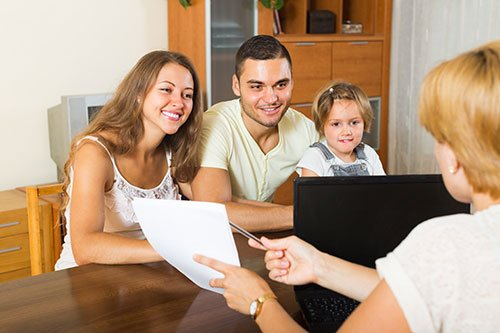 Family receiving expert insurance guidance by a Norgaard Agency Inc employee