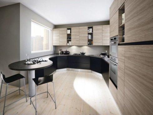una cucina angolare di color nero e marrone