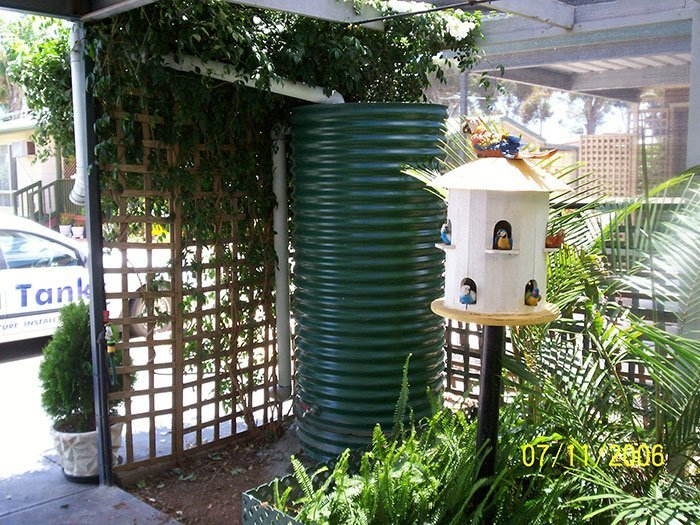 tall green cylinder tank in garden