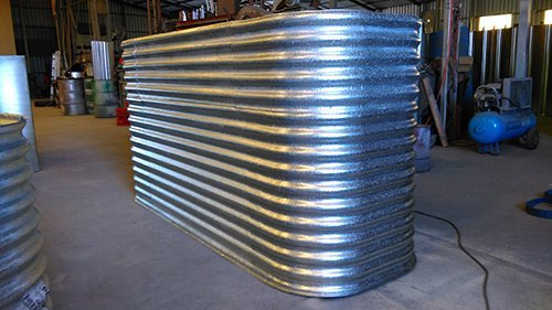 large tall metal tank with brackets