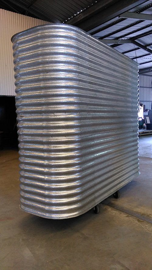 ribbed metal shaping into tank