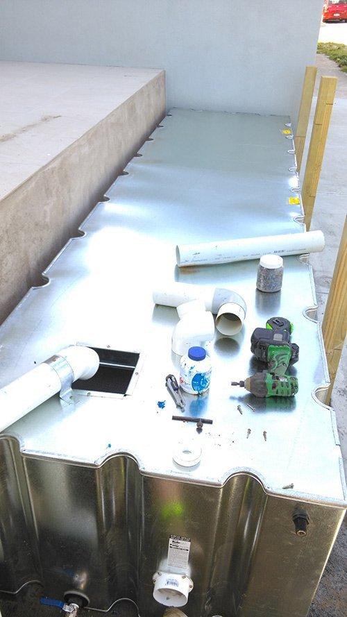 installing pipe on tank
