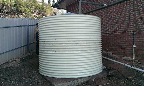 white cylinder tank