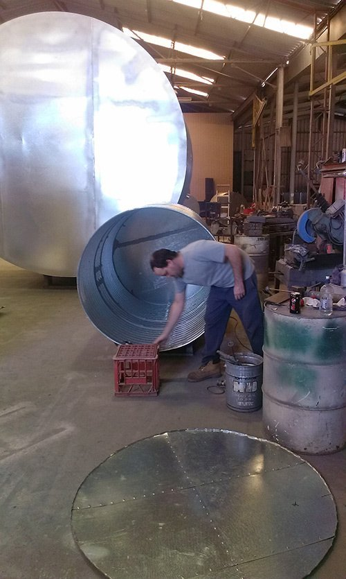 gentleman working on cylinder tank