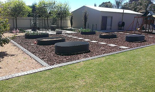 side view of landscaped garden with custom tanks