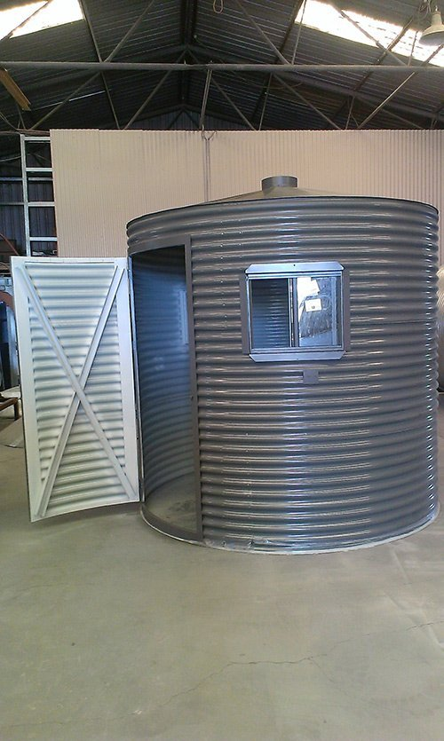 large view of opened door on circular tank