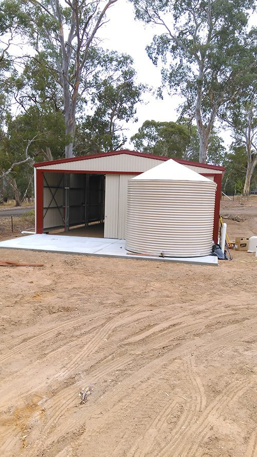 custom water tank outside shed