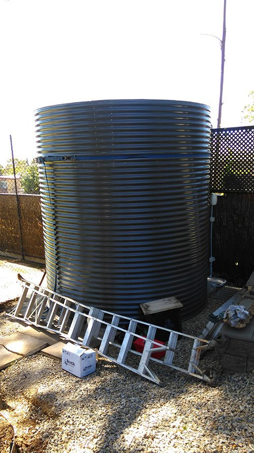 dark cylinder tank with ladder laid down