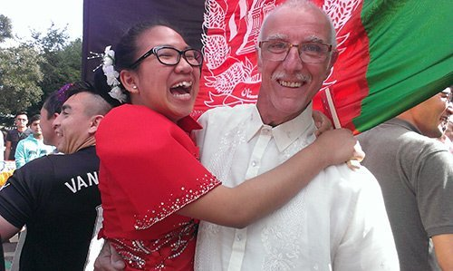 smiling couple in red and white celebrating