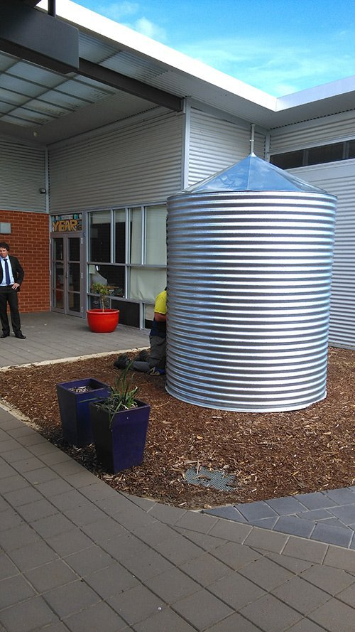 small metal silo with coned top