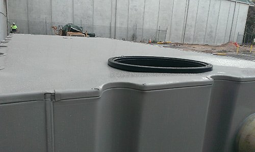 top of tank with hole for pipe