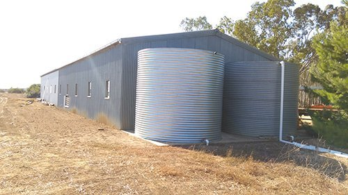 double tanks sitting in front of storage building