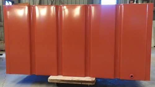 side view of red metal container