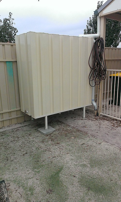 raised water tank with spout and hose