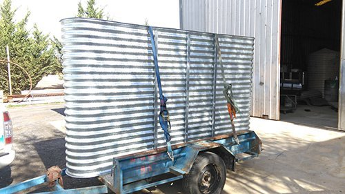 side view of metal container on trailer