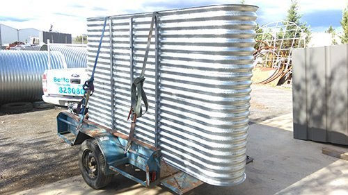 custom metal fabricated container loaded on small trailer