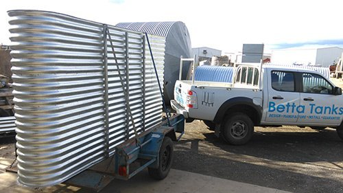 truck towing trailer with metal container