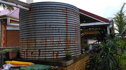 round rusting water tank