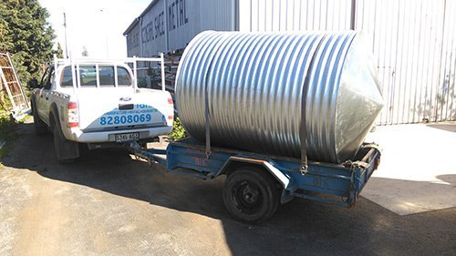 silver water tank on a trailer