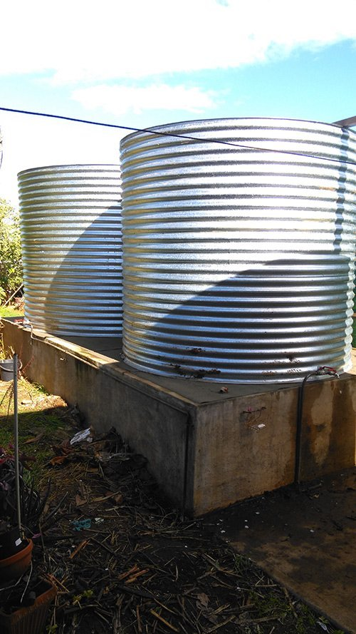 dual water tanks side by side on wooden platform