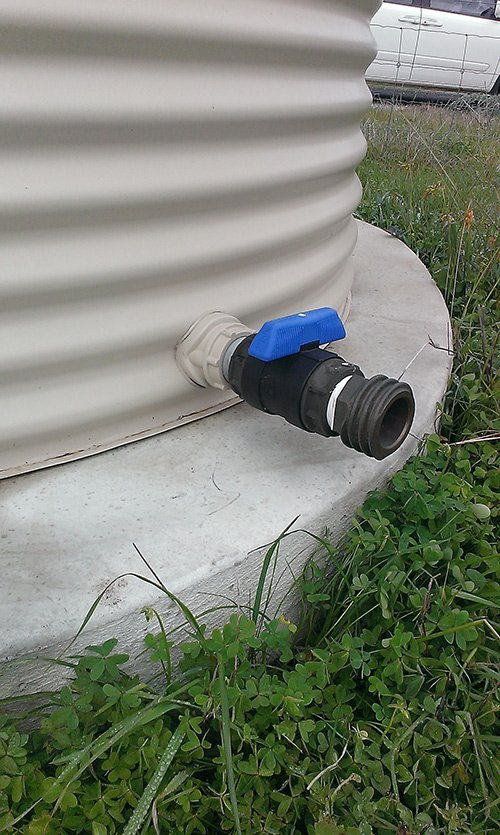white water tank with a black pipe and blue handle