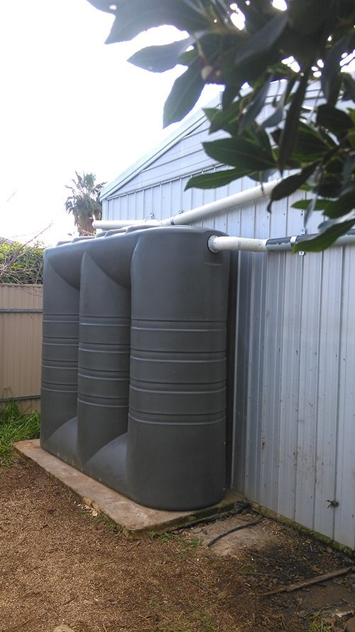 brown water tank with white pipes