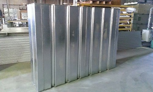silver rectangular water tanks with wooden mallets
