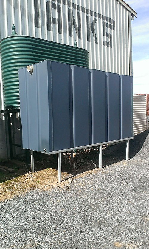 dark blue water tank on a white platform