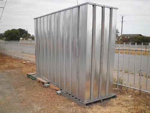 silver water tank up on pallets
